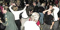 Swing dancers crowd the dance floor.