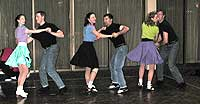 "Six dancers perform to a recording of ""Rock Around the Clock""."