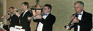 "The trumpet section, dressed in tuxes and black ties, plays a chorus of ""Alley Cat""."