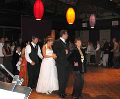 Dancers form a line on the wooden dance floor.
