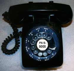 The 1940's desk phone dial shows its phone number: PA 6-5000.