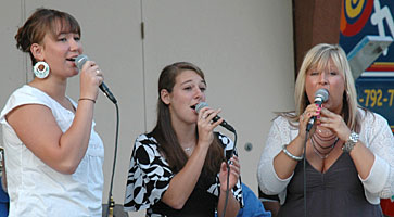 Val, Carly, and Laura sing at Central Park